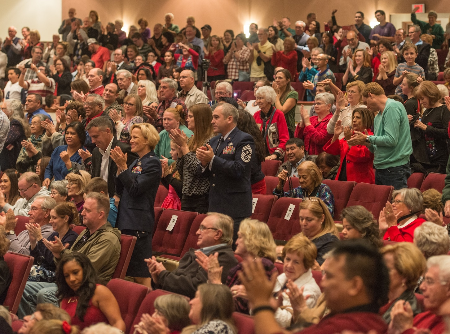 """The audience shows its approval as the U.S. Air Force Band of the West and the 323rd Army Band """"Fort Sam's Own"""" team up for a """"Holiday in Red, White and Blue"""" concert Dec. 10, 2017 at the Edgewood Performing Arts Center, 402 Lance St., in San Antonio. The annual performance is free and open to the public and is a holiday tradition."""