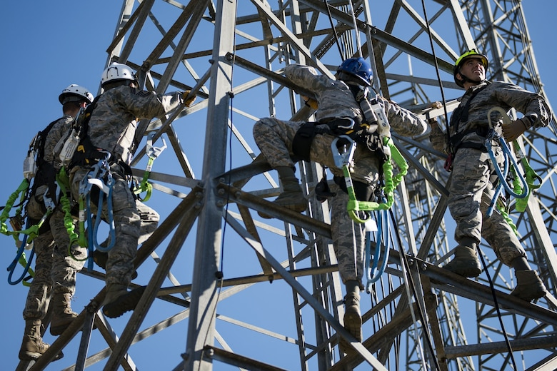Airmen from the 23rd Operations Squadron climb a radio antenna tower during an immersion tour, Dec. 11, 2017, at Moody Air Force Base, Ga. Wing leadership visited the radar, airfield and weather systems facilities to gain a better understanding of how they impact the mission. (U.S. Air Force photo by Airman 1st Class Erick Requadt)