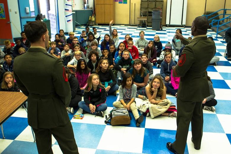 Marines answer questions for a group of students during a question-and-answer event at Friendly Hills Elementary School in Joshua Tree, Calif., Dec. 7, 2017. This is the first year the event took place at Friendly Hills. (U.S. Marine Corps photo by Pfc. Rachel K. Porter)