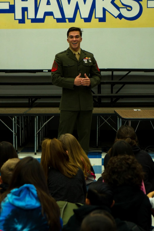 Sgt. Charles Bump, range safety officer, Marksmanship Training Unit, answers students' ques-tions during a question-and-answer event at Friendly Hills Elementary School in Joshua Tree, Calif., Dec. 7, 2017. This is the first year the event took place at Friendly Hills. (U.S. Marine Corps photo by Pfc. Rachel K. Porter)