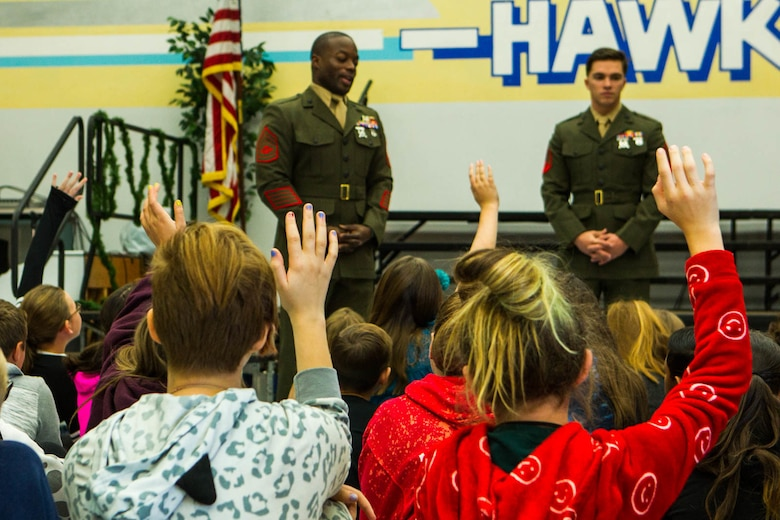 Students raise their hands to ask Marines questions during a question-and-answer event at Friendly Hills Elementary School in Joshua Tree, Calif., Dec. 7, 2017. This is the first year the event took place at Friendly Hills. (U.S. Marine Corps photo by Pfc. Rachel K. Porter)