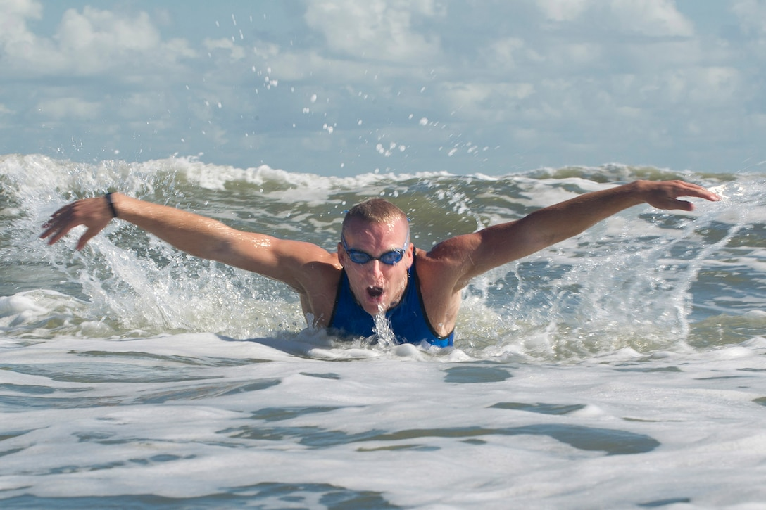 First Lt. Carl Eichert, a special nuclear events analyst for the Air Force Technical Applications Center, Patrick AFB, Fla., comes up for air while swimming in the Atlantic Ocean off Florida's Space Coast as he trains for the 2018 Ironman World Competition in Hawaii. (U.S. Air Force photo by Phillip C. Sunkel IV)