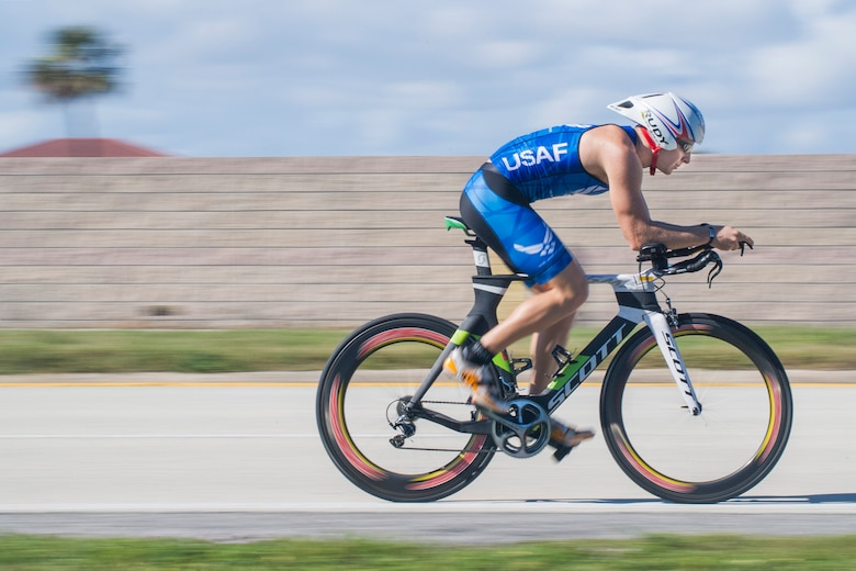First Lt. Carl Eichert, a special nuclear events analyst for the Air Force Technical Applications Center, Patrick AFB, Fla., races up State Road A1A along Florida's Space Coast in preparation for the 2018 Ironman World Championship in Hawaii.  Eichert qualified for the triathlon after competing in an event that consisted of a 1.2-mile swim, a 56-mile bike ride, and a 13.1 run.  (U.S. Air Force photo by Phillip C. Sunkel IV)