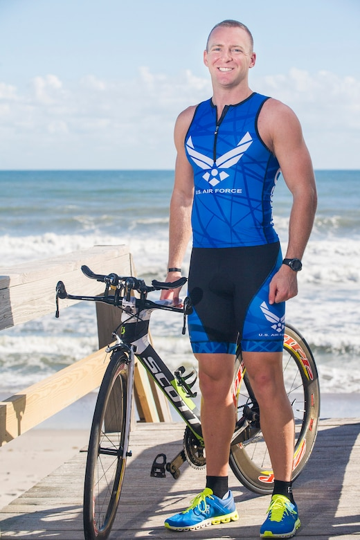 2018 World Ironman Championship competitor 1st Lt. Carl Eichert poses with his Scott Plasma 10 bicycle near the Atlantic Ocean along Florida's Space Coast.  Eichert, a special nuclear events analyst for the Air Force Technical Applications Center, Patrick AFB, Fla., was selected to participate in the triathlon in Kona, Hawaii, which consists of a 2.4-mile swim, 112-mile bike ride, and a full marathon of 26.2 miles.  (U.S. Air Force photo by Phillip C. Sunkel IV)
