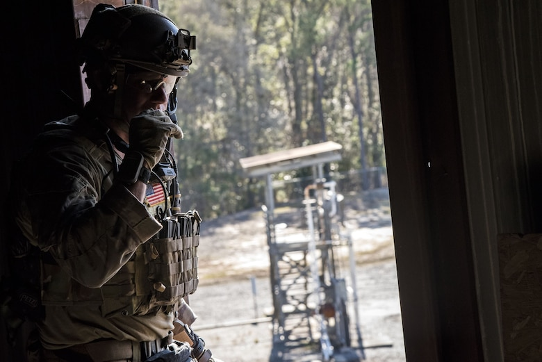 A pararesueman from the 38th Rescue Squadron (RQS) speaks on a radio during a full mission profile exercise, Dec. 12, 2017, at Moody Air Force Base, Ga. During the training, the 38th RQS recovered victims while under enemy fire to prepare for future search and rescue missions and to assess their unit's ability to work cohesively to accomplish the mission. (U.S. Air Force photo by Airman Eugene Oliver)