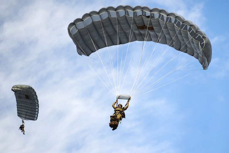 Pararescuemen from the 38th Rescue Squadron (RQS) parachute from an HC-130J Combat King II during a full mission profile exercise, Dec. 14, 2017, at Moody Air Force Base Ga. During the training, the 38th RQS recovered victims while under enemy fire to prepare for future search and rescue missions and to assess their unit's ability to work cohesively to accomplish the mission. (U.S. Air Force photo by Airman Eugene Oliver)