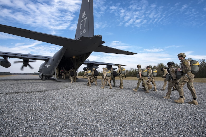 Pararescuemen from the 38th Rescue Squadron (RQS) enter an HC-130J Combat King II during a full mission profile exercise, Dec. 14, 2017, at Moody Air Force Base, Ga. During the training, the 38th RQS recovered victims while under enemy fire to prepare for future search and rescue missions and to assess their unit's ability to work cohesively to accomplish the mission. (U.S. Air Force photo by Airman Eugene Oliver)