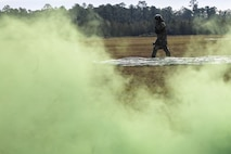 A pararescueman from the 38th Rescue Squadron (RQS) walks from a drop zone during a full mission profile exercise, Dec. 14, 2017, at Moody Air Force Base, Ga. During the training, the 38th RQS recovered victims while under enemy fire to prepare for future search and rescue missions and to assess their unit's ability to work cohesively to accomplish the mission. (U.S. Air Force photo by Airman Eugene Oliver)