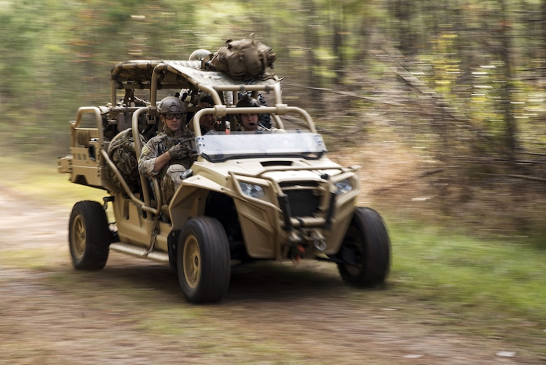 Airmen from the 38th Rescue Squadron (RQS)   drive a military RZR all-terrain vehicle during a full mission profile exercise, Dec. 14, 2017, at Moody Air Force Base, Ga. During the training, the 38th RQS recovered victims while under enemy fire to prepare for future search and rescue missions and to assess their unit's ability to work cohesively to accomplish the mission. (U.S. Air Force photo by Airman Eugene Oliver)