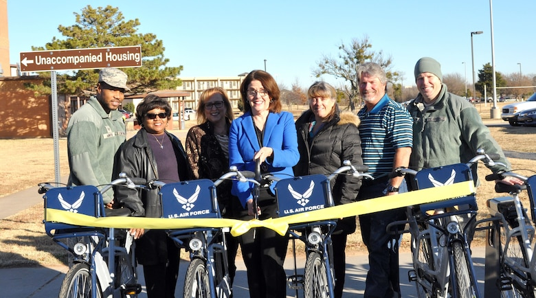 A group from the Tinker's 72nd Air Force Base Wing's Civil Engineering Directorate gathered for a ribbon-cutting ceremony introducing 10 new bikes that Team Tinker members can use across the base in four-hour segments.
