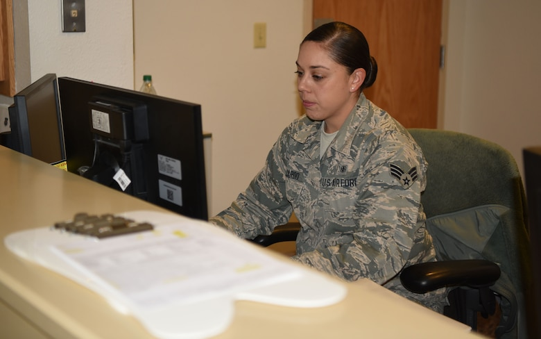Senior Airman Isabel Guajardo, 90th Medical Group dental assistant, works at the front desk of the dental clinic at F.E. Warren Air Force Base, Wyo., on Dec. 15, 2017. Isabel and her husband work together in the clinic and have proven it is possible to pursue success together at home and work.