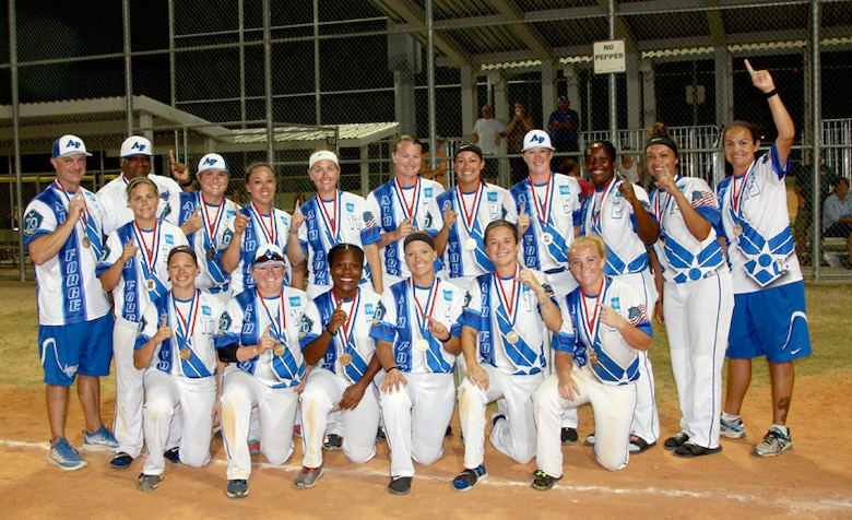 The All-Air Force women's softball team poses with their gold medals after the Armed Forces Tournament. (U.S. Air Force photo by Steve Brown / Released)