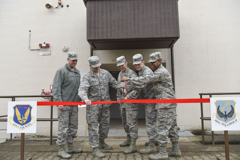 After years of waiting, U.S. Air Force Col. Jason Brown, 480th Intelligence, Surveillance and Reconnaissance Wing commander, and Col. Tracy Ward, 693rd Intelligence, Surveillance and Reconnaissance Group commander, cut the ribbon to open the newly-renovated Distributed Ground Station-4 operations facility on Nov. 15, 2017, at Ramstein Air Base, Germany.