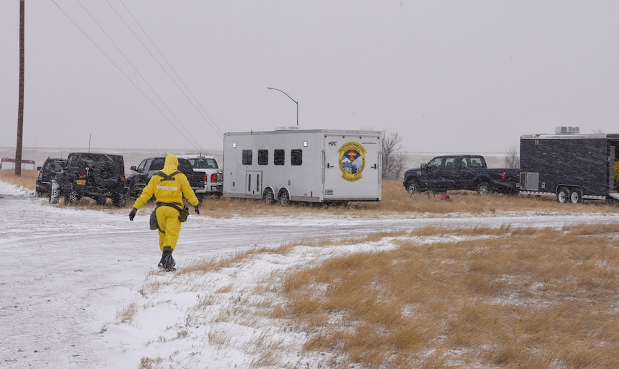 Senior Airman Mckenzie Williams, 90th Civil Engineering Squadron emergency management technician, walks to the emergency response trailer during an exercise on F.E. Warren Air Force Base, Wyo., Dec. 14, 2017. Emergency Management works with Explosive Ordinance Disposal, Fire Rescue and Bio-environmental to clean up after nuclear incidents of any kind. (U.S. Air Force photo by Airman 1st Class Braydon Williams)