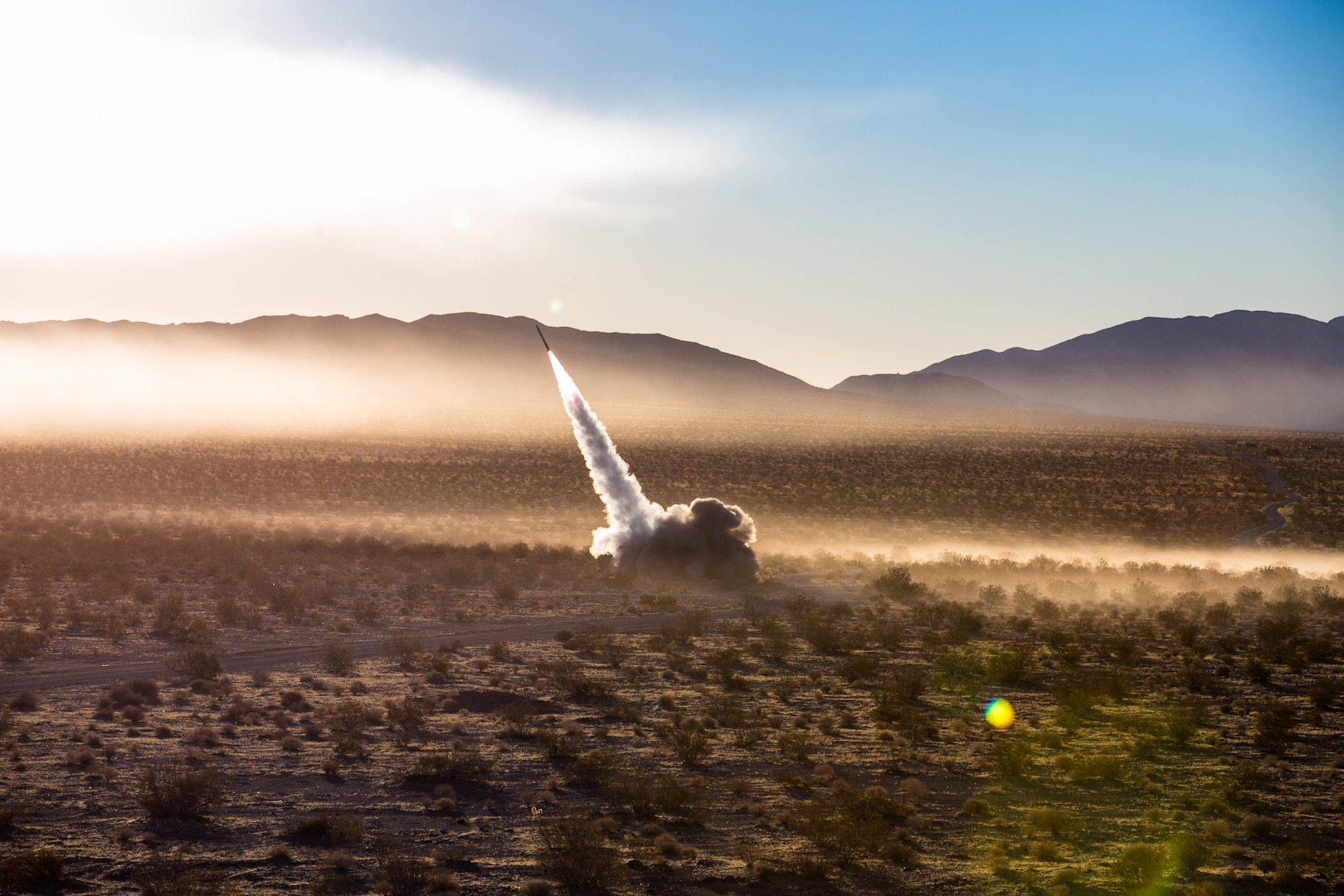 U.S. Marines assigned to Battery R, 5th Battalion, 11th Marine Regiment launch the High Mobility Artillery Rocket System from a Guided Multiple Launch Rocket System during Operation Steel Knight aboard the Marine Corps Air Ground Combat Center, Twentynine Palms, Calif., Dec. 7, 2017. HIMARS is a precision rocket system used to eliminate enemy positions with extreme accuracy. (U.S. Marine Corps photo by Pfc. William Chockey)