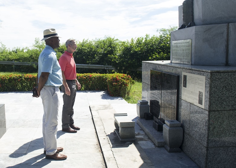 Gen. Terrence J. O'Shaughnessy, Pacific Air Forces commander, and Chief Master Sgt. Anthony Johnson, PACAF command chief, pay their respects to the Japanese soldiers lost during World War II on Corregidor Island, Philippines, during a historic tour of the island, Dec. 10.