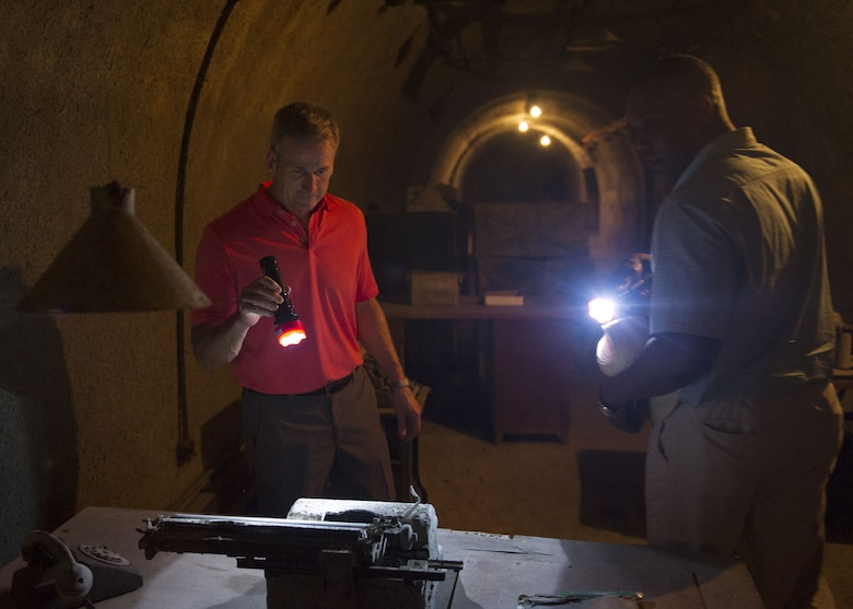 Gen. Terrence J. O'Shaughnessy, Pacific Air Forces commander and Chief Master Sgt. Anthony Johnson, PACAF command chief, examine a typewriter in a bunker on Corregidor Island, Philippines, during a historic tour of the island Dec. 10.