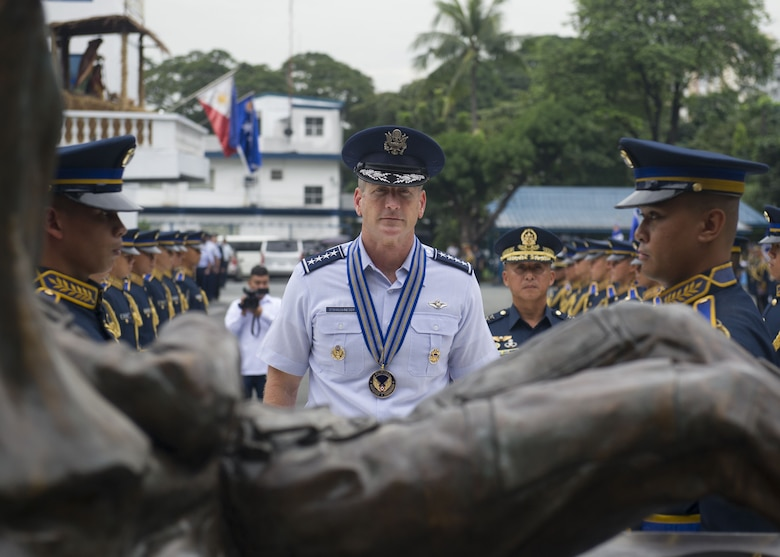 Gen. Terrence J. O'Shaughnessy, Pacific Air Forces commander and Lt. General Galileo Gerard Kintanar, Philippine Air Force commanding general, participate in a wreath laying ceremony at the Philippine Air Force Headquarters, Manila, Philippines, Dec. 11.