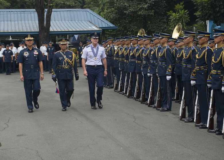 Gen. Terrence J. O'Shaughnessy, Pacific Air Forces commander, and Lt. General Galileo Gerard Kintanar, Philippine Air Force commanding general, review a formation of Philippine Air Force airmen, during a wreath laying ceremony at the Philippine Air Force Headquarters, Manila, Philippines, Dec. 11.