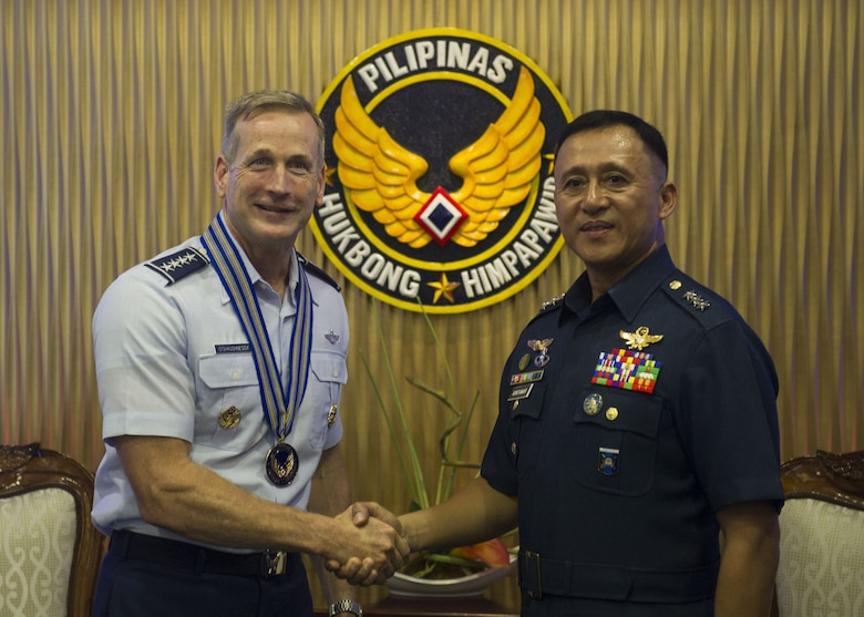 Gen. Terrence J. O'Shaughnessy, Pacific Air Forces commander and Lt. General Galileo Gerard Kintanar, Philippine Air Force commanding general, shake hands during an office call at the Philippine Air Force Headquarters, Manila, Philippines, Dec. 11.