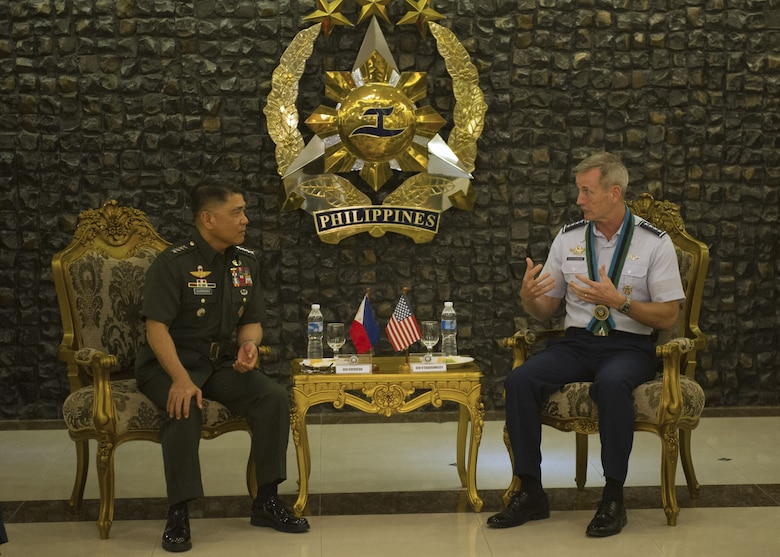 Gen. Terrence J. O'Shaughnessy, Pacific Air Forces commander, and General Rey Leonardo Guerrero, Armed Forces of the Philippines chief of staff, talk during an office call at General Head Quarters, Camp Aguinaldo, Manila, Philippines, Dec. 11.