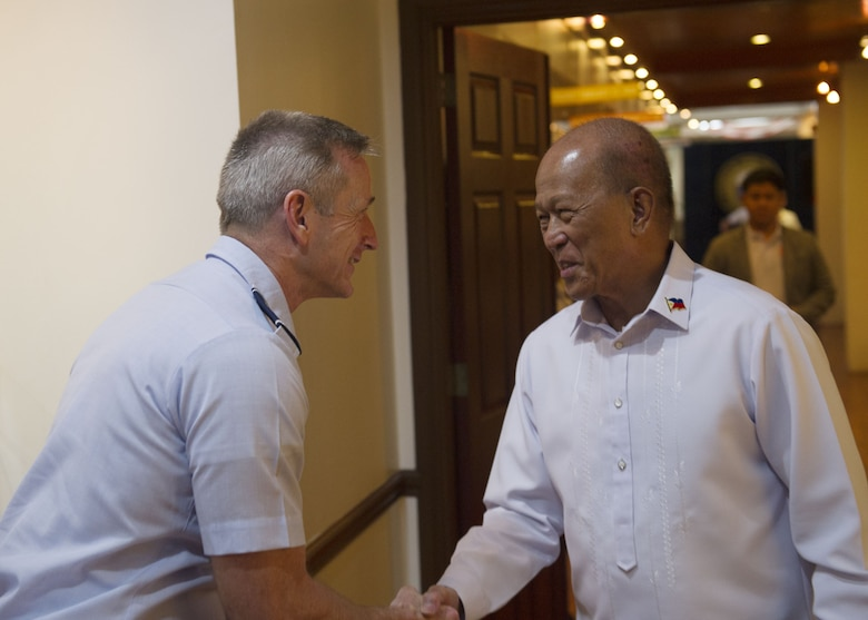 Gen. Terrence J. O'Shaughnessy, Pacific Air Forces commander, greets Delfin Lorenzana, Republic of Philippines Secretary of National Defense, at the Department of National Defense General, Camp Aguinaldo, Manila, Philippines, Dec. 11.