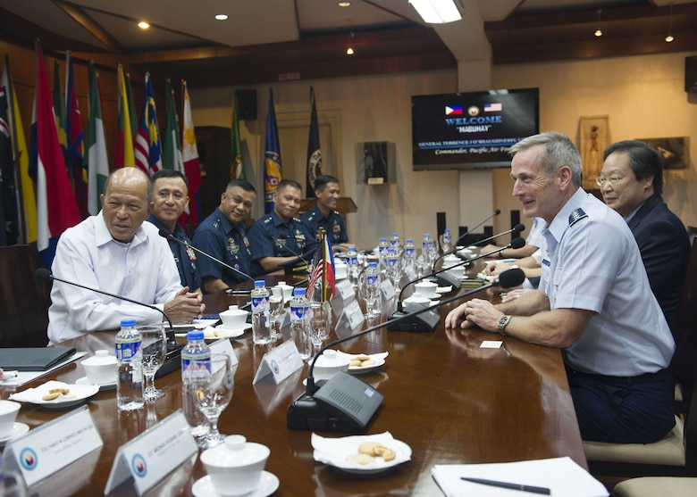 Gen. Terrence J. O'Shaughnessy, Pacific Air Forces commander, and Delfin Lorenzana, Republic of Philippines Secretary of National Defense, discuss opportunities to enhance interoperability and capacity with the Philippine Air Force and the Armed Forces of the Philippines at the Department of National Defense General, Camp Aguinaldo, Manila, Philippines Dec. 11.