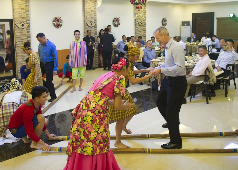 Gen. Terrence J. O'Shaughnessy, Pacific Air Forces commander, and Lt. Gen. Galileo Gerard Kintanar, Philippine Air Force commanding general, learn a traditional Filipino dance during a dinner hosted by the PAF, Manila, Philippines Dec. 11.