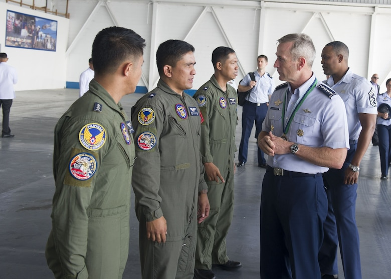 Gen. Terrence J. O'Shaughnessy, Pacific Air Forces commander, speaks with Philippines Air Force pilots during a visit to Clark Air Base, Philippines, Dec. 12.