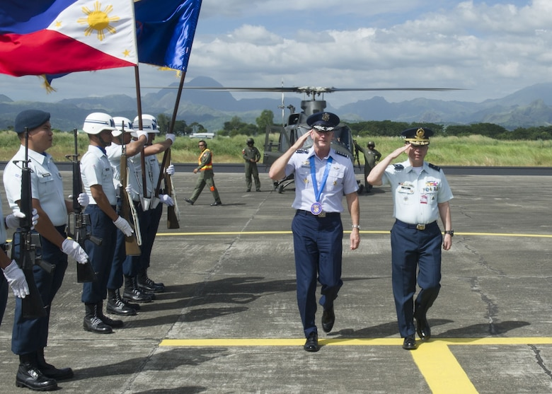Gen. Terrence J. O'Shaughnessy, Pacific Air Forces commander, is greeted by a formation of Philippine Air Force Airmen during a visit to Basa Air Base, Philippines, Dec. 12.