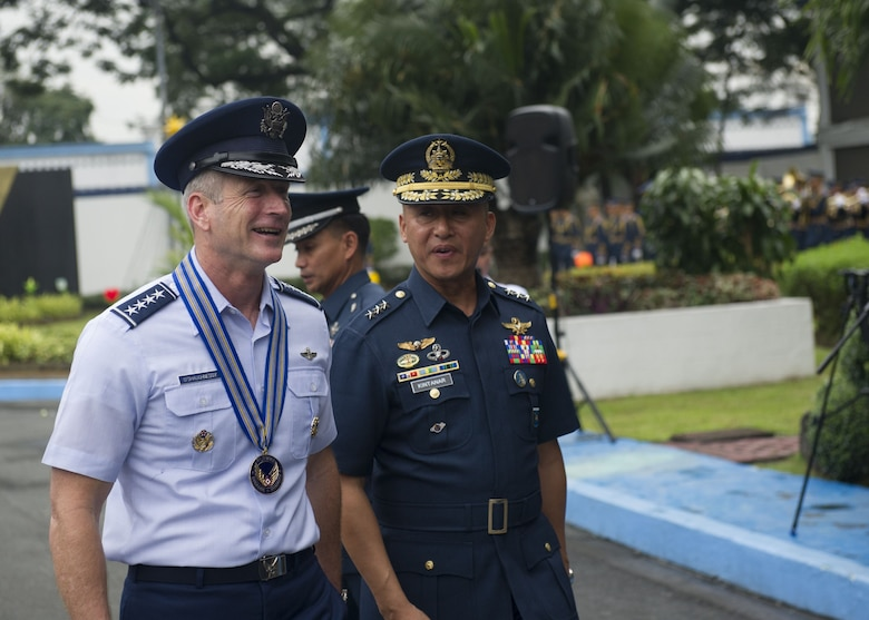 Gen. Terrence J. O'Shaughnessy, Pacific Air Forces commander, and Lt. General Galileo Gerard Kintanar, Philippine Air Force commanding general, speak following a wreath laying ceremony at the Philippine Air Force Headquarters, Manila, Philippines, Dec. 11.