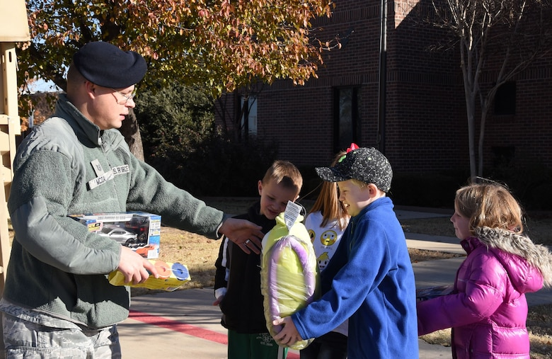 Tech. Sgt. Michael McDade, a 301st Security Forces Squadron member, collects toys from students at Haslet Elementary school in Haslet, Texas, Friday, Dec. 15, 2017, during the unit's annual Ruck for Kids drive. The toys are for kids who are hospitalized at Cook Children's Medical Center in Fort Worth, Texas. Students from O.A. Peterson, Haslet, and Sendera Ranch Elementary schools participated in the drive. (U.S. Air Force photos by Tech. Sgt. Melissa Harvey)