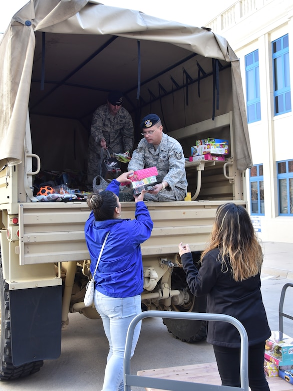 Cook Children's Medical Center employees help unload toy donations at the hospital from the annual 301st Security Forces Squadron Ruck for Kids drive Friday, Dec. 15, 2017, in Fort Worth, Texas. The toys are for kids who are hospitalized throughout the year. Students from O.A. Peterson, Haslet, and Sendera Ranch Elementary schools participated in the drive. (U.S. Air Force photos by Tech. Sgt. Melissa Harvey)