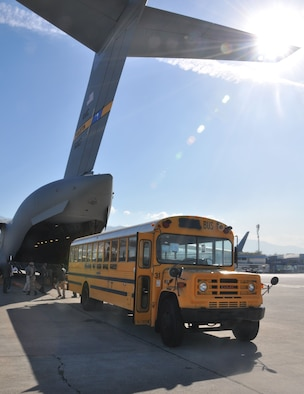 One of three school buses is offloaded in Haiti from a Joint Base Charleston C-17 aircraft, which transported it as humanitarian cargo that was donated to a Port-au-Prince outreach school, December 16, 2017.