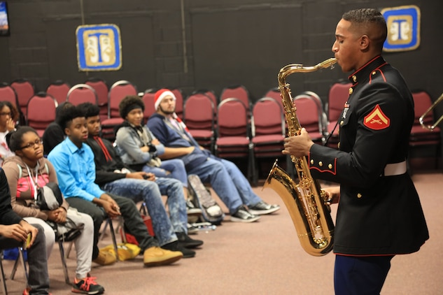 Lance Cpl. Erik Wright plays the saxophone at McCleur High School, Dec. 12, in Florissant, Missouri. Marines with the Marine Corps New Orleans Band entertained students and teachers at various high schools in and around the St. Louis area, Dec. 12-14, during its winter recruiting tour. Aside from playing music, the New Orleans, Louisiana-based Marines also educated and informed students and teachers about what life is like being a band Marine. (Official U.S. Marine Corps photo by GySgt. Bryan A. Peterson/Released)