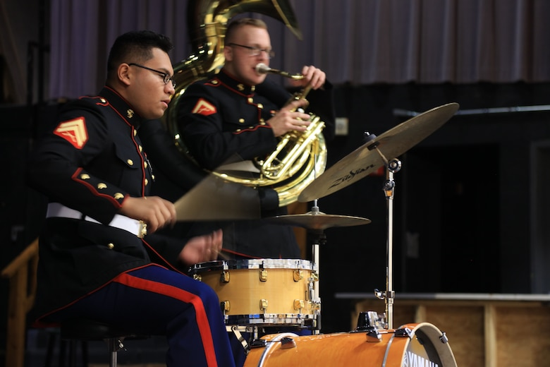 Corporal Vincente Rodriguez jams out with the drumset at McCleur High School, Dec. 12, in Florissant, Missouri. Marines with the Marine Corps New Orleans Band entertained students and teachers at various high schools in and around the St. Louis area Dec. 12-14 during its winter recruiting tour. Aside from playing music, the New Orleans, Louisiana-based Marines also educated and informed students and teachers about what life is like being a band Marine. (Official U.S. Marine Corps photo by GySgt. Bryan A. Peterson/Released)