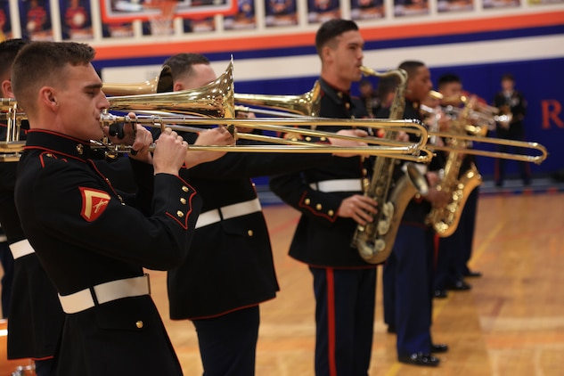 Marines with the Marine Corps New Orleans Band entertain students and teachers at various high schools in and around the St. Louis area, Dec. 12-14, during its winter recruiting tour. Aside from playing music, the New Orleans, Louisiana-based Marines also educated and informed students and teachers about what life is like being a band Marine. (Official U.S. Marine Corps photo by GySgt. Bryan A. Peterson/Released)