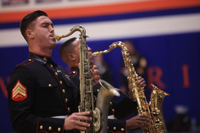 Sergeant Spencer Day plays the saxophone at Valley Park High School, Dec. 14, in Valley Park, Missouri. Marines with the Marine Corps New Orleans Band entertained students and teachers at various high schools in and around the St. Louis area, Dec. 12-14, during its winter recruiting tour. Aside from playing music, the New Orleans, Louisiana-based Marines also educated and informed students and teachers about what life is like being a band Marine. (Official U.S. Marine Corps photo by GySgt. Bryan A. Peterson/Released)