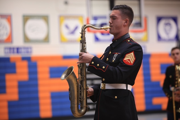Sergeant Spencer Day plays the saxophone at Valley Park High School, Dec. 14, in Valley Park, Missouri. Marines with the Marine Corps New Orleans Band entertained students and teachers at various high schools in and around the St. Louis area Dec. 12-14 during its winter recruiting tour. Aside from playing music, the New Orleans, Louisiana-based Marines also educated and informed students and teachers about what life is like being a band Marine. (Official U.S. Marine Corps photo by GySgt. Bryan A. Peterson/Released)