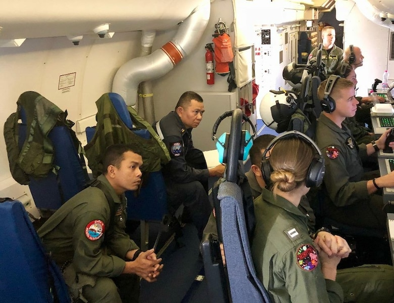 U-TAPAO, Thailand (Dec. 13, 2017) Lt. Kerri Englert demonstrates the tactical capabilities of the P-8A Poseidon to Lt. j.g. Wattanachai Chaochon, PO1 Rapeepong Morsomboon, and CPO1 Putthipong Lekdi of the Royal Thai Navy during SEASURVEX.