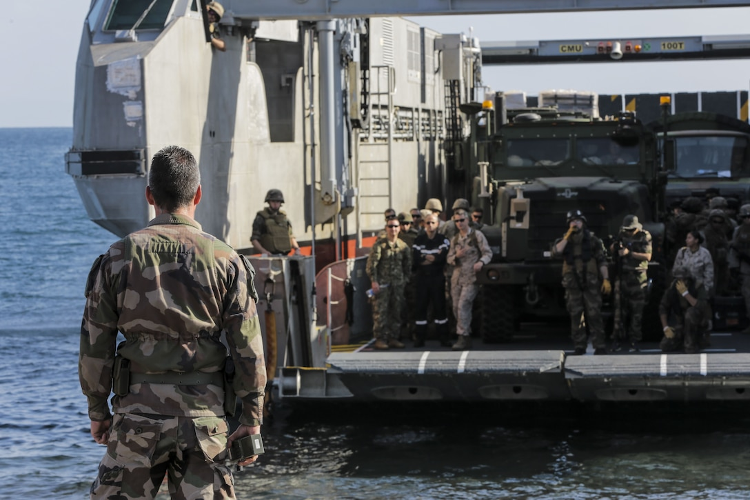 171210-M-QL632-084 DJIBOUTI, Djibouti (Dec. 14, 2017) – A French roll-on/roll-off catamaran landing craft prepares to offload U.S. Marines and Sailors with Naval Amphibious Forces, Task Force 51/5th Marine Expeditionary Brigade (TF 51/5) and the 15th Marine Expeditionary Unit during Alligator Dagger. Alligator Dagger, led by Naval Amphibious Force, Task Force 51/5th Marine Expeditionary Expedition Brigade, is a dedicated, bilateral combat rehearsal that combines U.S. and French forces to practice, rehearse and exercise integrated capabilities available to U.S. Central Command both afloat and ashore. (U.S. Marine Corps photo by Staff Sgt. Vitaliy Rusavskiy/Released)