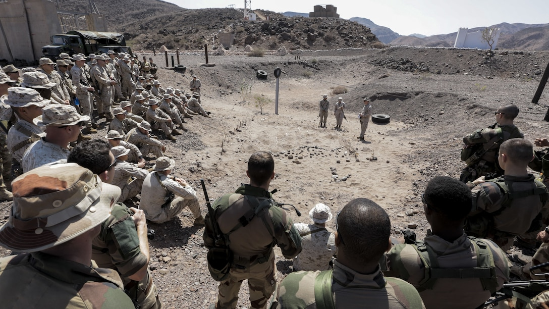 171214-M-QL632-004 DJIBOUTI, Djibouti (Dec. 14, 2017) – U.S. Marines and French military forces receive instructions prior to engaging in Alligator Dagger, a bilateral combat rehearsal. Alligator Dagger, led by Naval Amphibious Force, Task Force 51/5th Marine Expeditionary Expedition Brigade, is a dedicated, bilateral combat rehearsal that combines U.S. and French forces to practice, rehearse and exercise integrated capabilities available to U.S. Central Command both afloat and ashore. (U.S. Marine Corps photo by Staff Sgt. Vitaliy Rusavskiy/Released)