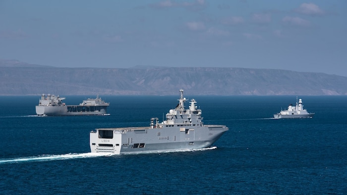 French navy Horizon-class frigate Chevalier Paul (D621) and French navy Mistral-class amphibious assault ship LHD Tonnerre (L9014) line up for a photo with the USS Lewis B. Puller (ESB 3) during Alligator Dagger, a combat rehearsal off the coast of Djibouti. The Expeditionary Mobile Base platform supports Naval Amphibious Force, Task Force 51/5th Marine Expeditionary Brigade's (TF 51/5) diverse missions that include crisis response, airborne mine countermeasures, counter-piracy operations, maritime security operations and humanitarian aid/disaster relief missions while enabling TF 51/5 to extend its expeditionary presence in the world's most volatile regions.