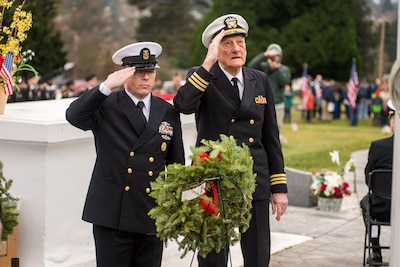 Navy Command Master Chief Petty Officer James Willis, left, command master chief of Naval Base Kitsap, Wash., and retired Navy Cmdr. Glen Brown, a World War II, Korea and Vietnam veteran, salute after placing a wreath honoring sailors at Ivy Green Cemetery's 6th annual Wreaths Across America event in Bremerton, Wash., Dec. 16, 2017. Navy photo by Petty Officer 2nd Class Wyatt L. Anthony
