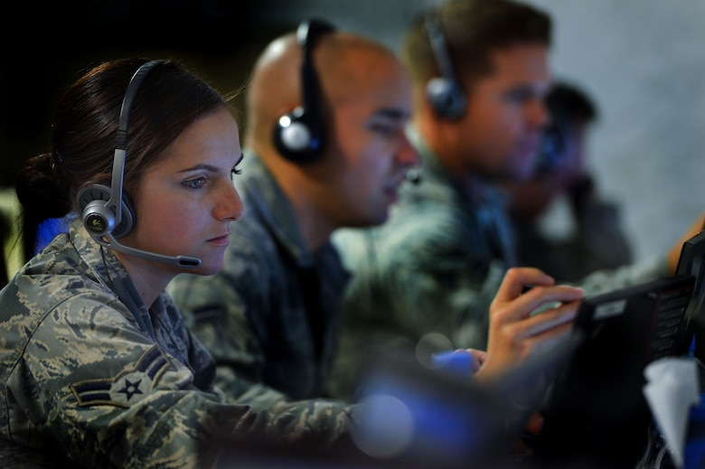 U.S. Air Force Airman 1st Class Lizandra Montero, 337th Air Control Squadron pilot simulator, controls threat scenarios projected to a training audience of U.S. military and allied armed forces members during Exercise Eagle Resolve 2013 in the Regional Air Operations Center in Doha, Qatar, April 24. When the 33rd Fighter Wing acquired it's current training mission under Air Education and Training Command it absorbed the 337 ACS, the Air Force's only Air Battle Manager school house. (U.S. Air Force photo by Kenny Holston/Released)