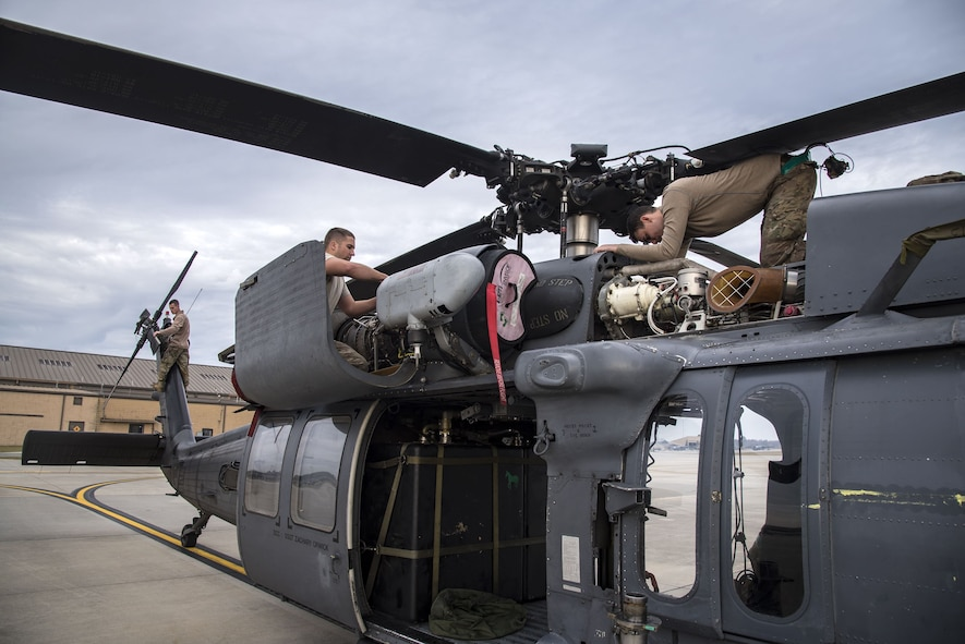 Airmen from the 723d Aircraft Maintenance Squadron (AMXS), perform maintenance on a HH-60G Pave Hawk, Dec. 15, 2017, at Moody Air Force Base, Ga. Members from the 723d Aircraft Maintenance Squadron (AMXS) and 23d Civil Engineer Squadron (CES) participated in a training day to help improve their readiness and get extra practice at their crafts. The AMXS performed maintenance on helicopters and the CES conducted rescue operations by extinguishing a mock fire within an HH-60G Pave Hawk and extracting injured victims. (U.S. Air Force photo by Airman Eugene Oliver)