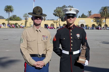 U.S. Marine Corps Lance Cpl. Tyler L. Archambeault, right, with Company F, 2d Recruit Training Battalion (2D RTBN), Recruit Training Regiment (RTR), poses for a photo with his senior drill instructor Staff Sgt Ryan. S. Jackson with Company F, 2D RTBN, RTR, after a graduation ceremony at Marine Corps Recruit Depot San Diego, Calif., Dec. 15, 2017. Archambeault received the Chesty Puller award and was named company honor graduate from Company F, 2D RTBN. (U.S. Marine Corps photo by Lance Cpl. Alexander L. Gist)