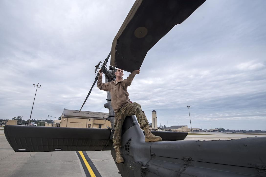 Staff Sgt. Dustin Stephens, 723d Aircraft Maintenance Squadron (AMXS) crew chief, pulls the rotors of an HH-60G Pave Hawk, Dec. 15, 2017, at Moody Air Force Base, Ga. Members from the 723d Aircraft Maintenance Squadron (AMXS) and 23d Civil Engineer Squadron (CES) participated in a training day to help improve their readiness and get extra practice at their crafts. The AMXS performed maintenance on helicopters and the CES conducted rescue operations by extinguishing a mock fire within an HH-60G Pave Hawk and extracting injured victims. (U.S. Air Force photo by Airman Eugene Oliver)