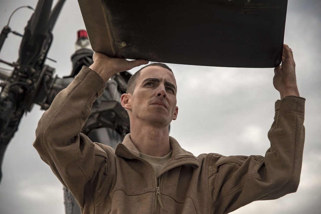 Staff Sgt. Dustin Stephens, 723d Aircraft maintenance squadron (AMXS) crew chief, grabs the main rotor of an HH-60G Pave Hawk, Dec. 15, 2017, at Moody Air Force Base, Ga. Members from the 723d Aircraft Maintenance Squadron (AMXS) and 23d Civil Engineer Squadron (CES) participated in a training day to help improve their readiness and get extra practice at their crafts. The AMXS performed maintenance on helicopters and the CES conducted rescue operations by extinguishing a mock fire within an HH-60G Pave Hawk and extracting injured victims. (U.S. Air Force photo by Airman Eugene Oliver)