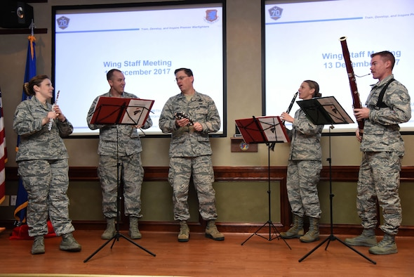 Col. C. Mike Smith, 81st Training Wing vice commander, performs a song with The U.S. Air Force Band of the West, Nightwatch, during the 81st Training Wing staff meeting at Stennis Hall Dec. 13, 2017, on Keesler Air Force Base, Mississippi. During the two-day visit to Keesler the band performed for Airmen and local residents throughout various locations at Keesler and the nearby area. Their mission is to honor military heritage through music, connect with the American public and inspire patriotism and excellence. (U.S. Air Force photo by Kemberly Groue)